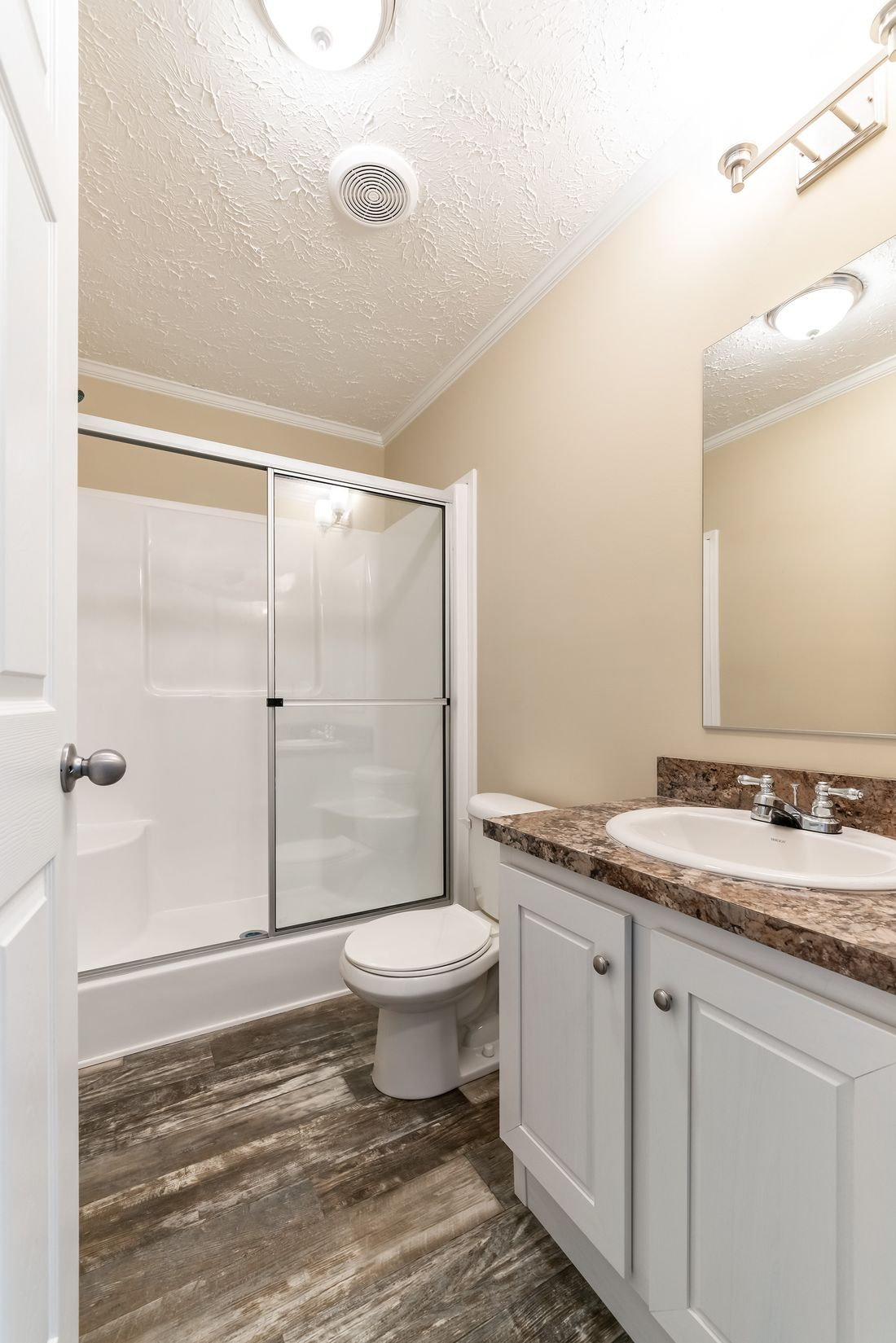 "The 4611 ""HOMESTEAD"" 6028 Guest Bathroom. This Manufactured Mobile Home features 3 bedrooms and 2 baths."
