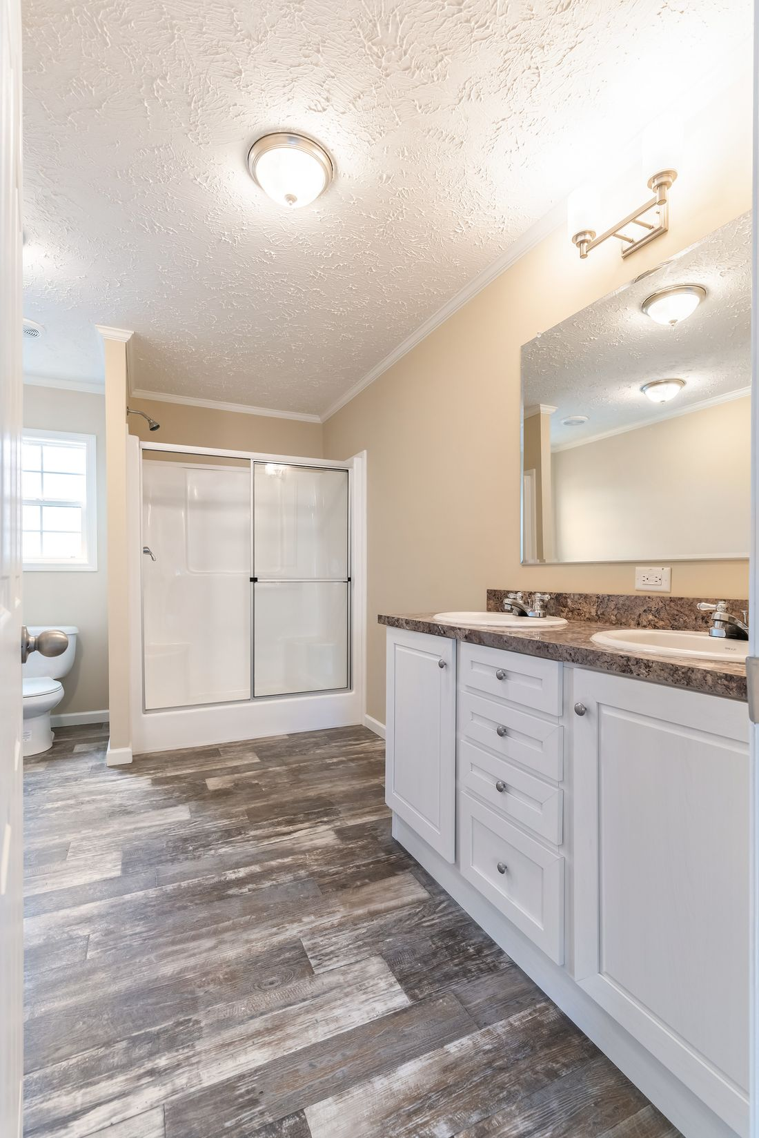 "The 4611 ""HOMESTEAD"" 6028 Master Bathroom. This Manufactured Mobile Home features 3 bedrooms and 2 baths."