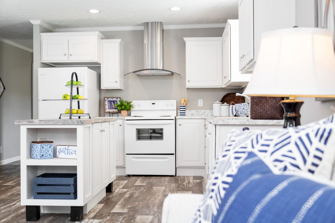 The 930 THE SAVANNAH 7616 Kitchen. This Manufactured Mobile Home features 3 bedrooms and 2 baths.