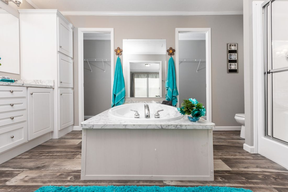 The 2360 ROCKETEER 6828 Master Bathroom. This Manufactured Mobile Home features 3 bedrooms and 2 baths.
