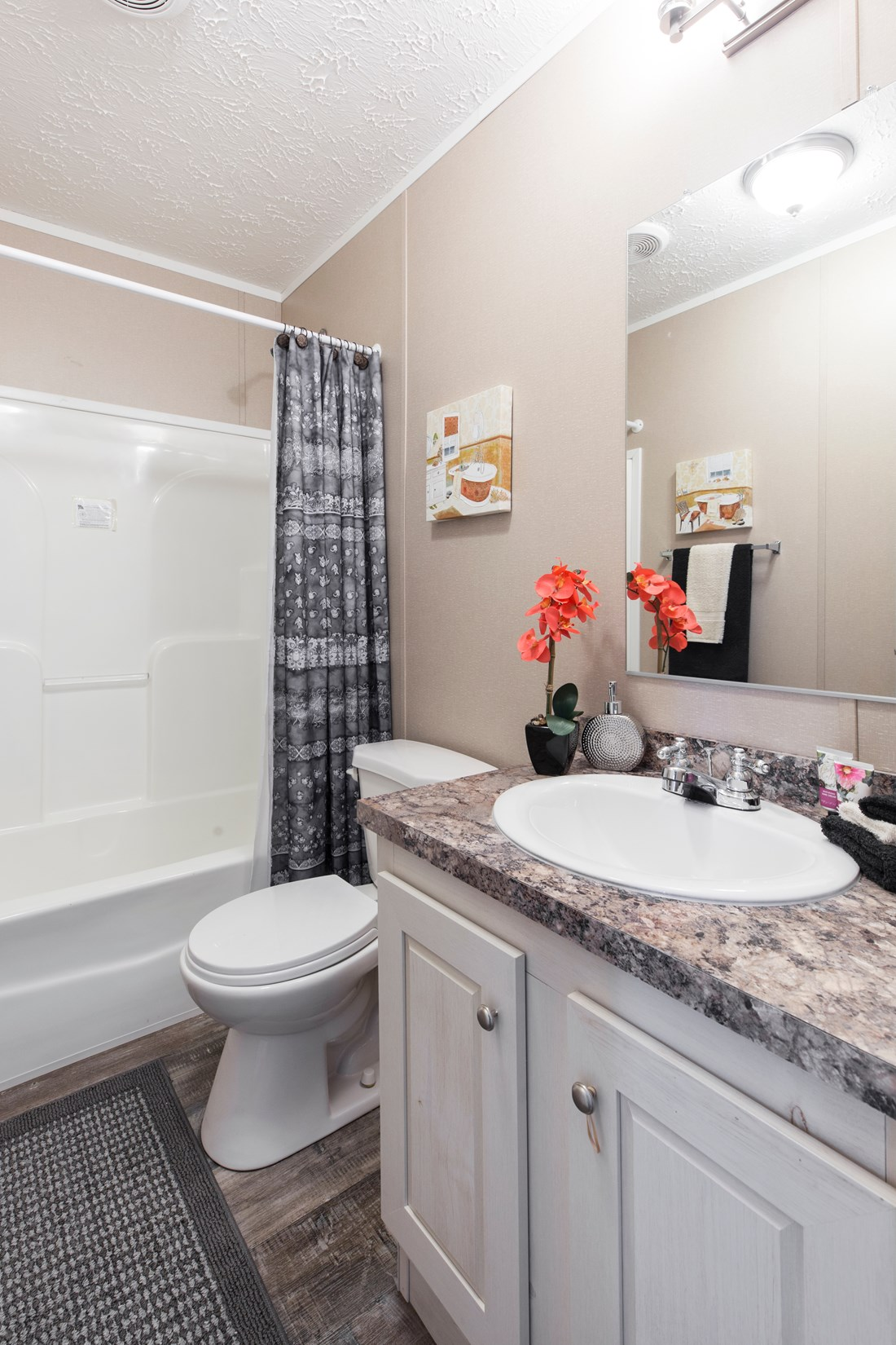 The 900  ADVANTAGE PLUS 5616 Guest Bathroom. This Manufactured Mobile Home features 2 bedrooms and 2 baths.