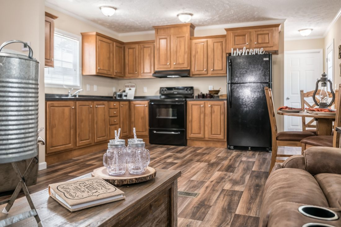 The 4615 ADVANTAGE PLUS 6616 Kitchen. This Manufactured Mobile Home features 3 bedrooms and 2 baths.