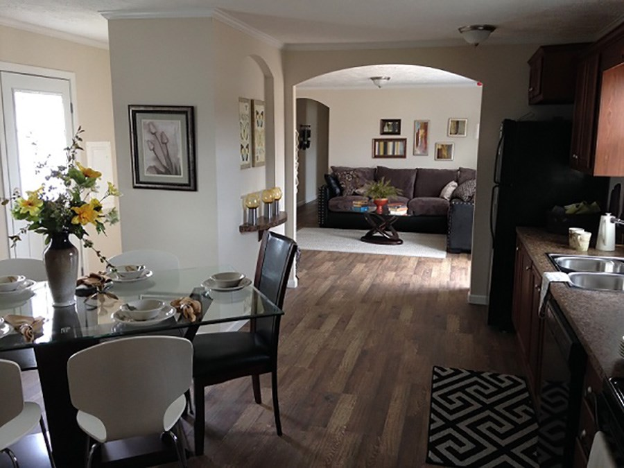 The 921  ADVANTAGE PLUS 7216 Dining Area. This Manufactured Mobile Home features 3 bedrooms and 2 baths.