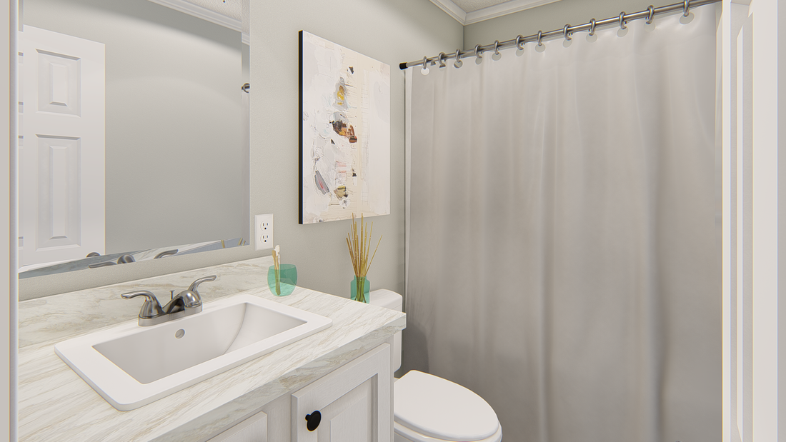 The 101  ADVANTAGE PLUS 7616 Guest Bathroom. This Manufactured Mobile Home features 3 bedrooms and 2 baths.